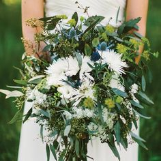 """Marisa's oversize bouquet was a mix of eucalyptus, airplants, thistle, mums, Queen Anne's lace and freesia. """"I wanted it to look big and wild, as if I had just picked it myself that morning,"""" Marisa says."""