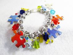 Autism Awareness Puzzle Bracelet:  The maker  used the colors for Autism, blue, light blue, red, and yellow, for the puzzle pieces.