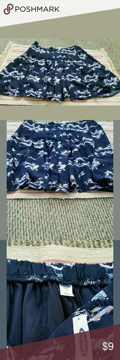 Old Navy large island print skirt. New with tags! Very cute large size skirt from Old Navy. Blue with scenes of islands and sailboats and palm trees. Slight pleats, above knee and full skirt. The back of the waistband stretches. Shell : 100% rayon lining: 100% polyester. Retailed for $35. Comes from a pet and smoke free home. Very willing to bundle and will consider ALL offers! Old Navy Skirts Circle & Skater