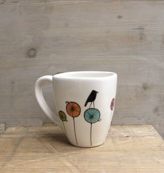I love coffee ~ I bet you do too! this is a perfect mug for any warm beverage. It holds up to 12oz. keep this for yourself or give to a friend. this mug is made out of a low fire white clay and was hand drawn and hand painted by me. measures 4 inches in diameter and is 3.5 inches