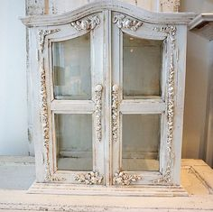 Ornate cabinet showcase white distressed shabby cottage chic wood w/ glass display embellished garland roses  home decor anita spero design