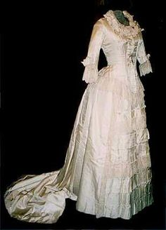Cream colored Victorian bustle gown, another option for a wedding dress.