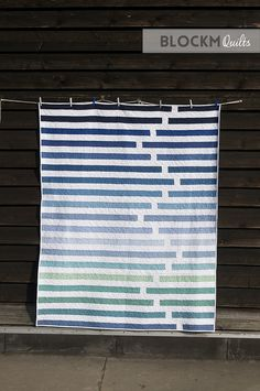 """Fun """"Regatta"""" quilt by Daniela O'Connell of Block M Quilts. Modern strip quilt, perfect for Jelly Rolls Jellyroll Quilts, Scrappy Quilts, Easy Quilts, Owl Quilts, Patchwork Quilting, Quilt Festival, Quilting Projects, Quilting Designs, Quilting Ideas"""