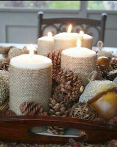 Bring in some warmth and texture for fall using burlap wrapped candles and pinecones to create an easy centerpiece