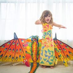 She bypassed the butterflies and went right for the dragon when we gave into her pleas for a kite. Don't let the dresses fool you into thinking she's just a girly girl. She's actually a pretty rough and tumble kid with LOTS of different interests. But yeah, she did insist on a dress to match the kite too ;) #fashionbymayhem