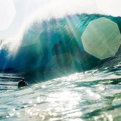 Early morning lens flare at the Wedge with tribesman Tommy Cantrell. Photo by our pal Luke Forgay. #hippytreetribe #surfandstone
