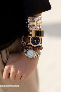 layered luxury watches make for a unique twist on the arm party ... and a great way to show some watch-love!