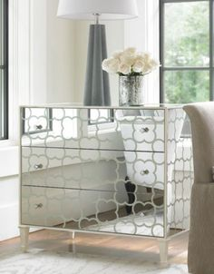 Gorgeous Mirrored Chest Of Drawer With Decorative Hardware Idea Feat Silver Flower Vase Decor Plus Awesome Table Lamp Design