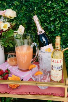 Perfect daytime bar cart: champagne, lillet, and fresh squeezed grapefruit juice