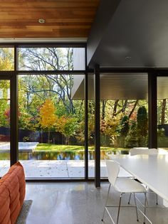 Cedarvale Ravine House - Drew Mandel Architects. Everything about this!!! Large Windows, trees, water, white kitchen furniture, orange couch, modern, love!