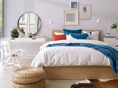 Spring textile lay on a MALM queen bed frame and white side table lit with 2 lamps