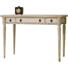 Showcasing fluted legs and ribbon-detailed trim, this distressed writing desk is a perfect addition to your home office or den.