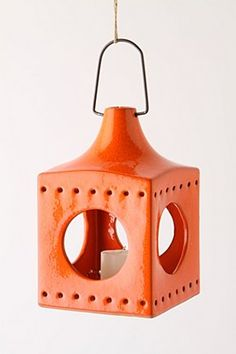 This lantern is too cute - $28 from Anthro and it comes in four colors (orange, dark blue, brown and yellow).