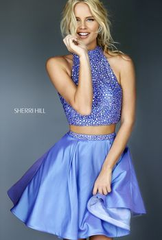 Enticing and ebullient, the Sherri Hill 11317 two-piece prom dress offers sensational swing on the dance floor. The halter neck crop top is beautifully embellished with all over tonal beads and showcases a sleek keyhole on the back. The flared satin A-line skirt showcases a beaded waistband and finishes in a breezy mid-thigh hemline.