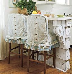 slipcovered barstools.  shabby chic kitchen
