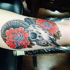 Ram skull with traditional roses tattoo by Robert Knox aka Rev. Bob at Lucky 13 RVA.