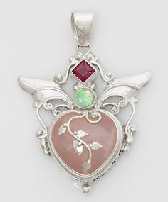 The Loving Heart pendant is an elegant design by Shankari the Alchemist featuring a sweet Rose Quartz Heart. Set with Garnet and White Opal triplet. Handmade in Sterling Silver, Inspired and Created in Sacred Space with the clear purpose of Opening the Heart of the wearer.