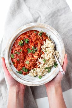 Slow Cooker Chicken Tikka Masala is a lightened up comforting Indian dish made with tomato sauce, chicken breast, coconut milk and various flavorful, bold spices. Serve with brown rice or naan for a full meal!