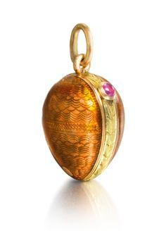 A Fabergé gold and enamel miniature egg pendant locket, workmaster Michael Perchin, St Petersburg, circa 1895.