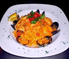 Ferruccine with seafood in blush sauce.