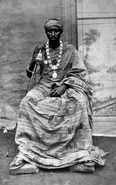 "Africa | ""King Sakite of East-Krobo, whose capital is Odumase. The necklace and the sword were presented to him by Queen Victoria. His robe is indigenous.""  Krobo, Eastern Region, Ghana.  ca. 1871 - 1882 