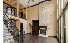 A two story living room calls for a two story fireplace