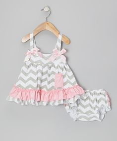 With ruffles all over, this sweet set has it all. The swing tunic sports a tier hem, bows at the shoulders and a pick-up in back—perfect for showcasing that fancy, frilly diaper cover.