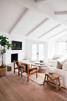 white ceiling. white walls. all white with wood and leather