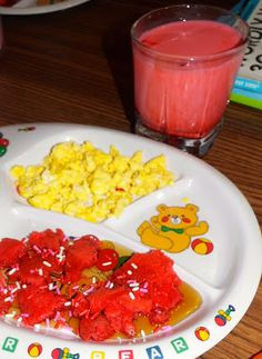 This easy to make Valentines day meal idea is perfect to serve to your kids on Valentine's Day. Includes red heart pancakes colored milk.