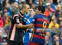 Barcelona's Uruguayan forward Luis Suarez argues with Espanyol's goalkeeper Pau Lopez during the Spanish league football match FC Barcelona vs RCD...