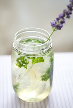Lavender Mojito - white rum, lavender syrup, lime juice, mint leaves, and sparkling water.  The perfect summer sip!