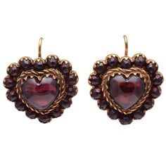 Retro Jewelry Beautiful antique heart shaped earrings in bohemian garnet. Large beautifully rounded center stone surrounded by smaller cabochon garnets. Set in garnet gold gold wires. A very feminine and…MoreMore Garnet Jewelry, Garnet Earrings, Gold Drop Earrings, Wedding Earrings, Heart Jewelry, Boho Earrings, Fine Jewelry, Jewellery Rings, Dainty Jewelry