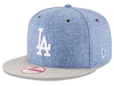 This exclusive Los Angeles Dodgers New Era MLB 2 Tweed 9FIFTY Snapback Cap brings style to your life and favorite Major League Baseball team.  The tweed pattern material, strongly-embroidered logo, side patch and air-cooling eyelets allow for a sophisticated look. The adjustable strapped fit keeps you comfortable all season long.