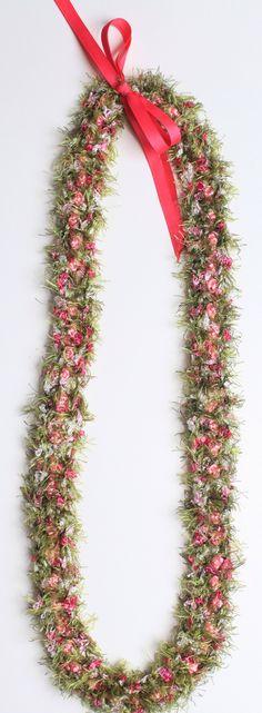 Flat crochet lei using pink 1mm rattail, fern and moss eyelash yarn and multi-pink kalina yarn.