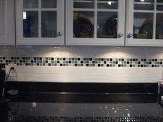 Cutting mosaics into strips is a very cost effective way to make an accent for your tile backsplash.  Another advantage is, if you one day get tired of the mosaic, you can remove the mosaic strip and replace it with another.