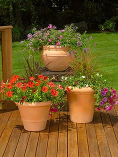 One of our 7 tips for improving your deck or patio: Place Pots Precisely!  Outdoor Backyard Decorations plants