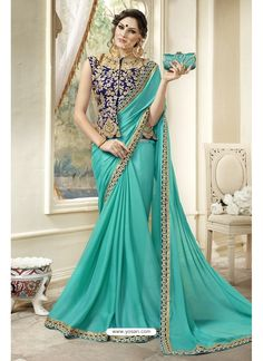 Turquoise saree with blouse. Work - Embroidered patch border and embroidery work on blouse. The blouse can be customized up to Paired with matching blouse piece. Silk Saree Blouse Designs, Fancy Blouse Designs, Indian Designer Outfits, Designer Dresses, Designer Wear, Designer Sarees, Sari Dress, Maxi Dresses, Ethnic Dress