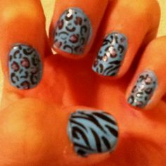 Zebra/cheetah nail. Paint your nails any color you want. Then use a toothpick and acrylic paint to paint on the cheetah print. I used a sinful colors nail art nail polish to do the zebra. Enjoy!