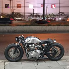 Triumph Bonneville Cafe Racer metal motorcycle in the night lights. Cb 750 Cafe Racer, Triumph Cafe Racer, Custom Cafe Racer, Cafe Racer Motorcycle, Retro Motorcycle, Harley Davidson, Cool Motorcycles, Triumph Motorcycles, Moto Scrambler