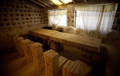 Tables and chairs made from blocks of salt are seen at the salt hotel on Uyuni salt lake