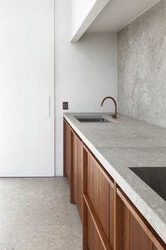 Concrete countertop? Wooden units.