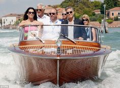 Love the wood water taxi boat...George Clooney looks good too!...