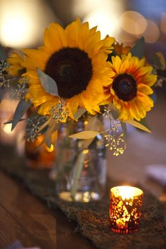 sunflowers and candlelight centerpiece www.tablescapesbydesign.com https://www.facebook.com/pages/Tablescapes-By-Design/129811416695