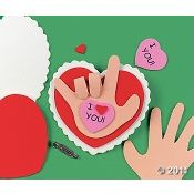 We made Valentine's Day cards with this idea out of cardstock and a tracing of Sean's hand.