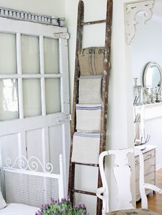 """I found a small """"country-type"""" wood ladder which I'm going to repurpose into a towel rack - now just gotta figure out a good way to attach to the wall."""