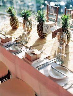 pineapple centerpieces make for great (and inexpensive) wedding decor. Pineapple Centerpiece, Fruit Centerpieces, Beach Wedding Centerpieces, Wedding Decorations, Table Decorations, Centerpiece Ideas, Hawaiian Centerpieces, Pineapple Decorations, Centrepiece Wedding