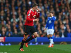 Manchester United defender Phil Jones holds his nose after being bloodied in a challenge in the first-half at Goodison Park