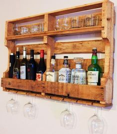 Hand Made Pallet Wine and Whiskey Rack Pallet Wine Rack Diy, Diy Pallet Sofa, Wood Wine Racks, Wooden Pallet Projects, Wood Pallet Furniture, Pallet Ideas To Sell, Pallet Headboards, Pallet Benches, Pallet Tables