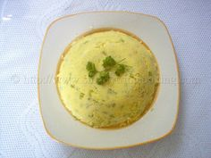 Cornmeal Coo Coo | 1 medium onion, grated 1 tsp. garlic, grated 10 small ochroes, sliced thinly 2 tbsp.powdered seasoning of choice (for taste) 1 tbsp. butter ½ cup water 2 cup coconut milk 1 cup yellow cornmeal 1 tsp. chive Salt to taste 1 small pepper and pimento pepper, thinly chopped, for taste (optional)