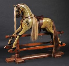 *Rocking horse. A fine Edwardian English dapple grey rocking horse by F.H. Ayres for Harrods
